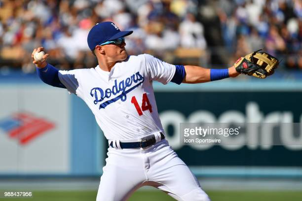 Los Angeles Dodgers outfielder Enrique Hernandez throws to first during a MLB game between the Colorado Rockies and the Los Angeles Dodgers on June...