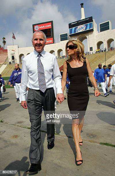 Los Angeles Dodgers owner Frank McCourt and his wife Jamie walk into the Memorial Coliseum prior to the start of the game against the Boston Red Sox...
