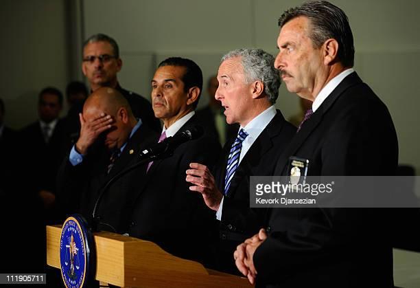 Los Angeles Dodgers owner Frank McCourt speaks as Los Angeles Police Department Chief Charlie Beck Los Angeles Mayor Antonio Villaraigosa and...