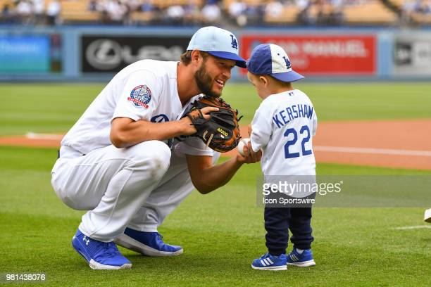 Los Angeles Dodgers pitcher Clayton Kershaw hands a ball to his son before a MLB game on Father's Day between the San Francisco Giants and the Los...