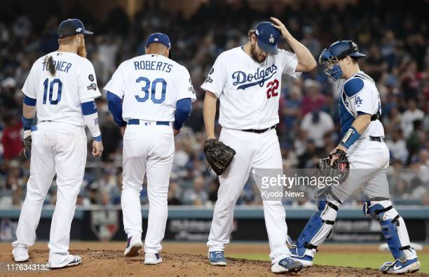 Los Angeles Dodgers pitcher Clayton Kershaw leaves the mound after allowing the Washington Nationals backtoback home runs in the eighth inning of...