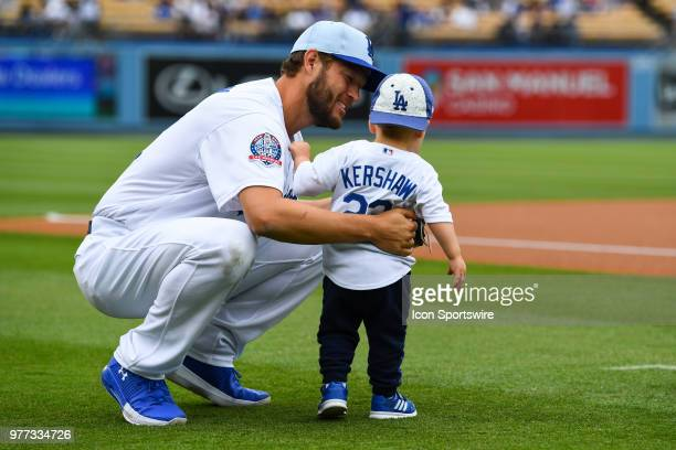 Los Angeles Dodgers pitcher Clayton Kershaw plays with his son before a MLB game on Father's Day between the San Francisco Giants and the Los Angeles...