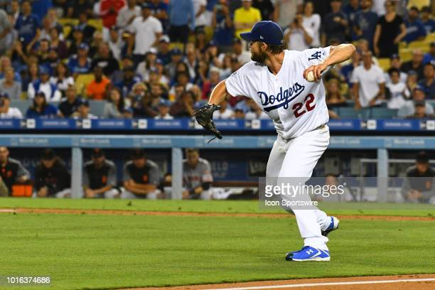 Los Angeles Dodgers pitcher Clayton Kershaw throws out San Francisco Giants outfielder Hunter Pence during a MLB game between the San Francisco...