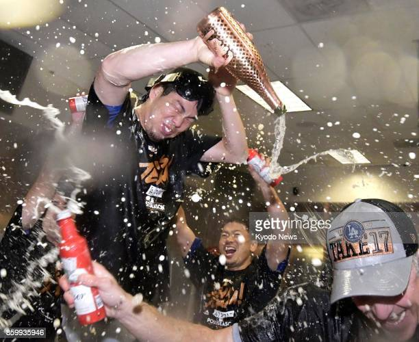 Los Angeles Dodgers pitcher Kenta Maeda and teammates shower each other in champagne in Phoenix Arizona on Oct 9 2017 as they celebrate the Dodgers...