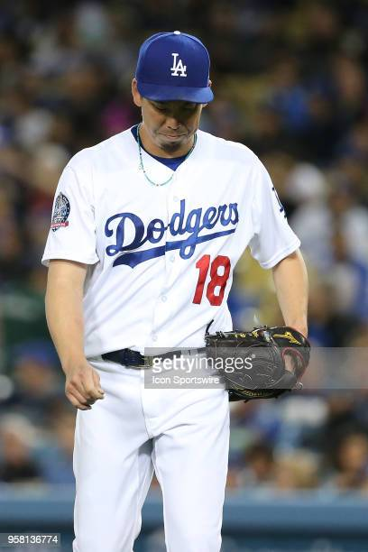 Los Angeles Dodgers Pitcher Kenta Maeda makes the long walk back tot he dugout after being pulled after giving up five earned runs in 4 1/3 innings...