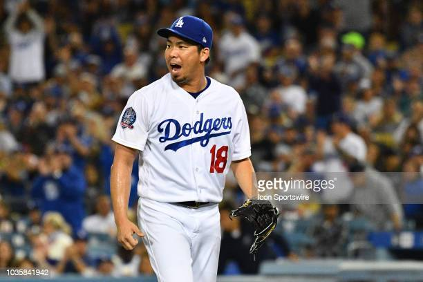 Los Angeles Dodgers pitcher Kenta Maeda reacts to striking out the side during a MLB game between the Colorado Rockies and the Los Angeles Dodgers on...