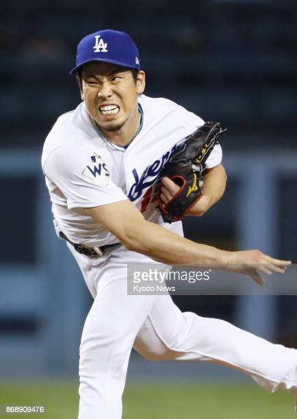Los Angeles Dodgers pitcher Kenta Maeda throws in the seventh inning against the Houston Astros in Game 6 of the World Series at Dodger Stadium in...