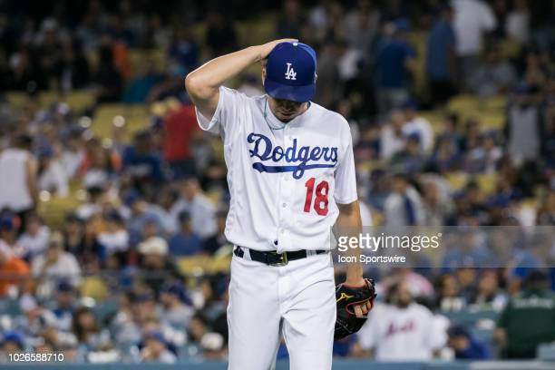 Los Angeles Dodgers pitcher Kenta Maeda walks off the field after being pulled by Dodgers manager Dave Roberts in the top of the 9th inning during a...