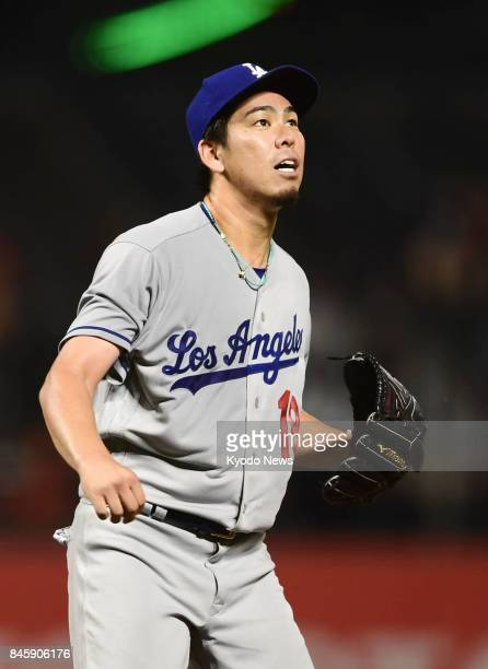 Los Angeles Dodgers pitcher Kenta Maeda watches a solo home run by Jarrett Parker of the San Francisco Giants in the second inning at ATampT Park in...