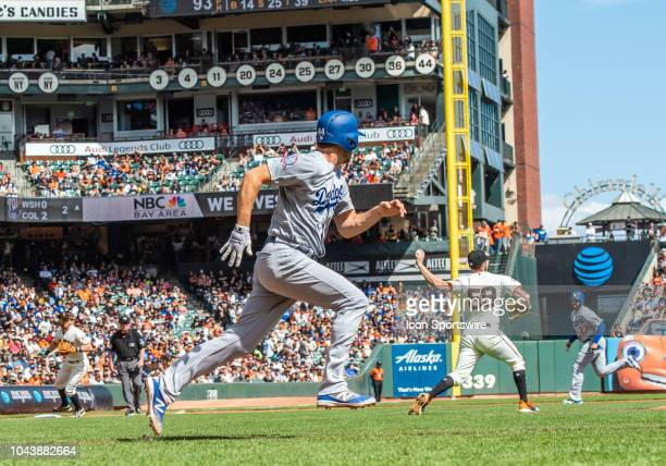 Los Angeles Dodgers Pitcher Rich Hill heads to first base after a bunt while San Francisco Giants Pitcher Andrew Suarez throws to second base to...