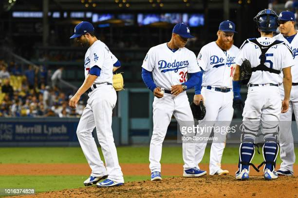 Los Angeles Dodgers pitcher Scott Alexander is taken out of the game by manager Dave Roberts after giving up the lead in the ninth inning during a...