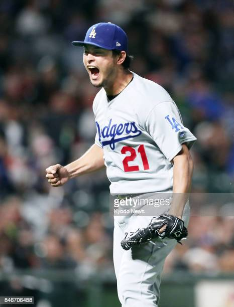 Los Angeles Dodgers pitcher Yu Darvish reacts after getting Buster Posey of the San Francisco Giants to hit into an inningending double play in the...