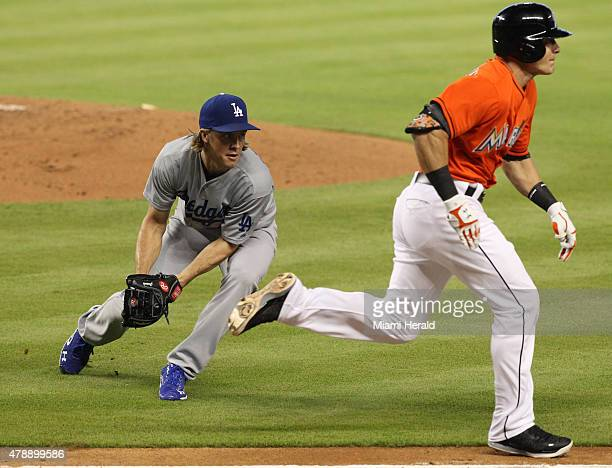 Los Angeles Dodgers pitcher Zack Greinke throws to first base to take out Miami Marlins' Derek Dietrich during the second inning on Sunday June 28 at...