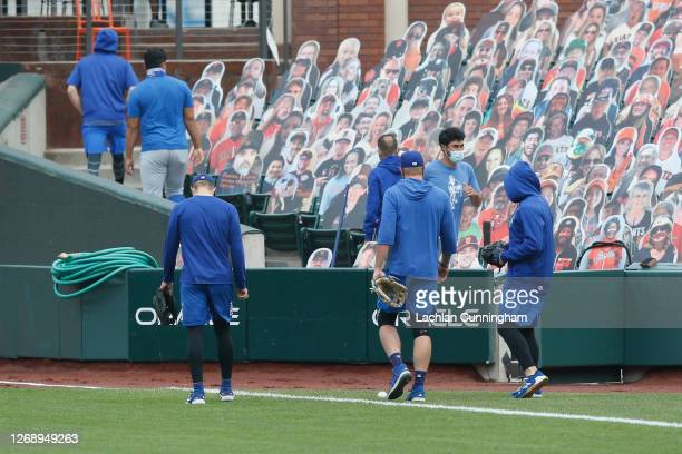 Los Angeles Dodgers players and staff leave the field before the postponement of the game against the San Francisco Giants at Oracle Park on August...
