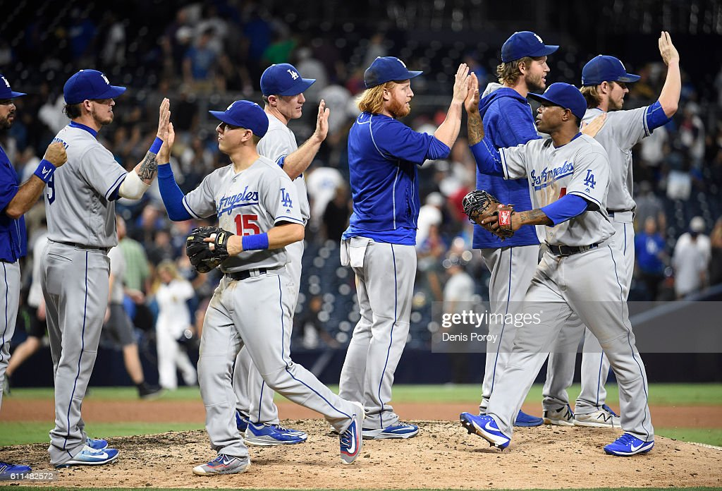 Los Angeles Dodgers players celebrate after beating the San Diego Padres 9-4 in a baseball game at PETCO Park on September 29, 2016 in San Diego, California.