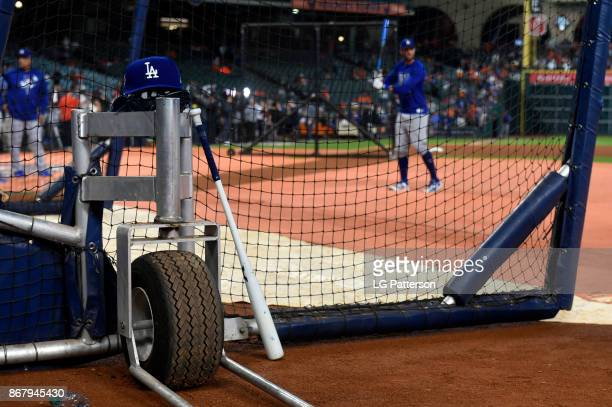 Los Angeles Dodgers player's hat and bat are seen on the batting cage during batting practice prior to Game 5 of the 2017 World Series against the...