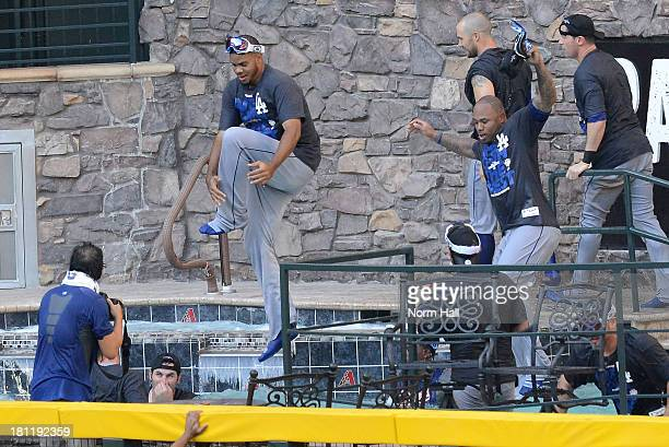 Los Angeles Dodgers players jump in the pool after clinching the National League West after a 7-6 win against the Arizona Diamondbacks at Chase Field...