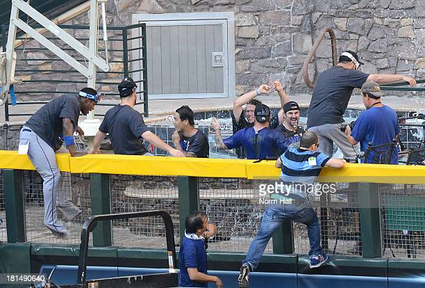 Los Angeles Dodgers players jump in the pool after clinching the National League West after a 76 win against the Arizona Diamondbacks at Chase Field...