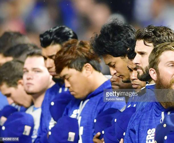 Los Angeles Dodgers players observe a moment of silence before a game against the San Francisco Giants at ATampT Park in San Francisco on Sept 11 the...