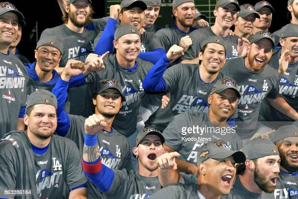 Los Angeles Dodgers players pose for photos after beating the Chicago Cubs in the National League Championship Series Game 5 111 in Chicago on Oct 19...