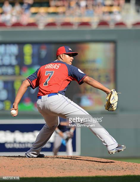Los Angeles Dodgers prospect Julio Urias of the World Team pitches during the 2014 SiriusXM AllStar Futures Game against Team USA at Target Field on...