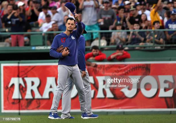 Los Angeles Dodgers relief pitcher and former Red Sox player Joe Kelly tips his cap to the fans as he walks out to the bullpen during the second...