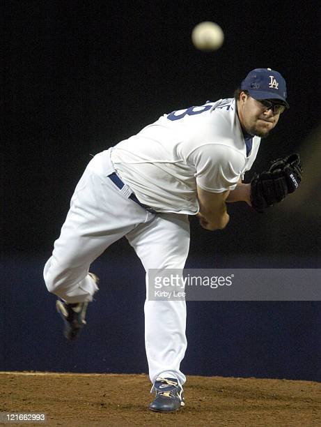 Los Angeles Dodgers reliever Eric Gagne was the losing pitcher in 64 loss to the Florida Marlins after giving up four runs in the ninth inning at...