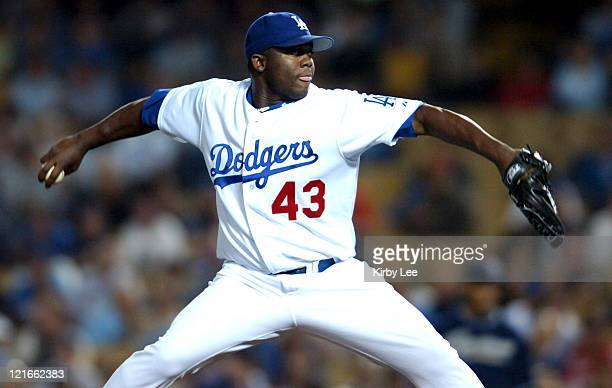 Los Angeles Dodgers reliever Yhency Brazoban pitches during ninth inning of 54 victory over the San Diego Padres at Dodger Stadium in Los Angeles...