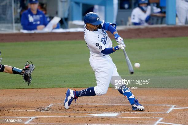 Los Angeles Dodgers right fielder Mookie Betts hits a lead off home run off Arizona Diamondbacks pitcher Corbin Martin in the first inning at Dodger...