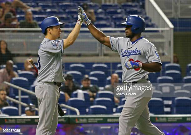 Los Angeles Dodgers right fielder Yasiel Puig is congratulated by pitcher Kenta Maeda after hitting a solo home run during the fourth inning of a...