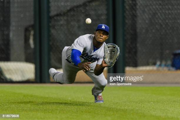 Los Angeles Dodgers right fielder Yasiel Puig makes a diving catch off the bat of Chicago White Sox left fielder Melky Cabrera in the 8th inning...