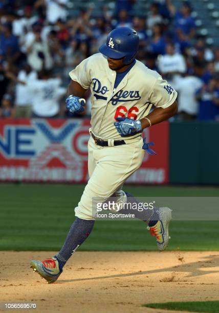 Los Angeles Dodgers right fielder Yasiel Puig rounds the bases after Puig hit a solo home run in the ninth inning of a game against the Los Angeles...