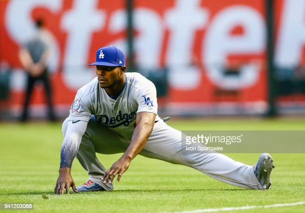 Los Angeles Dodgers right fielder Yasiel Puig stretches before the MLB baseball game between the Arizona Diamondbacks and the Los Angeles Dodgers on...