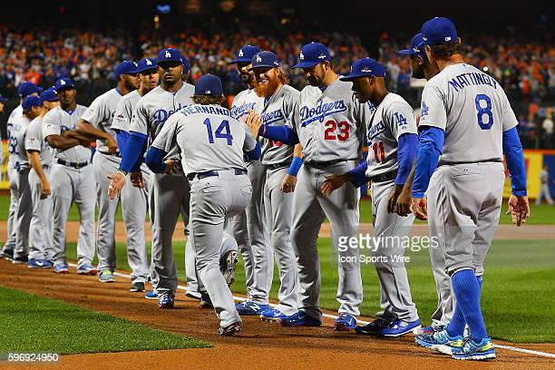 Los Angeles Dodgers second baseman Enrique Hernandez high fives his teammates during player introductions prior to Game 3 of the National League...