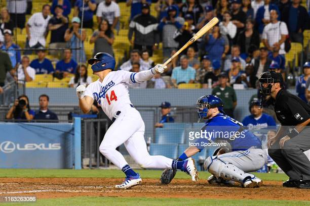 Los Angeles Dodgers second baseman Enrique Hernandez hits a walk off single during a MLB game between the Toronto Blue Jays and the Los Angeles...