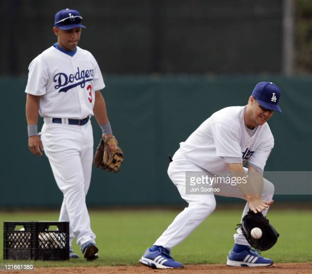 Los Angeles Dodgers second baseman Jeff Kent fields grounders while shortstop Cesar Izturis looks on during the first full squad workout at...