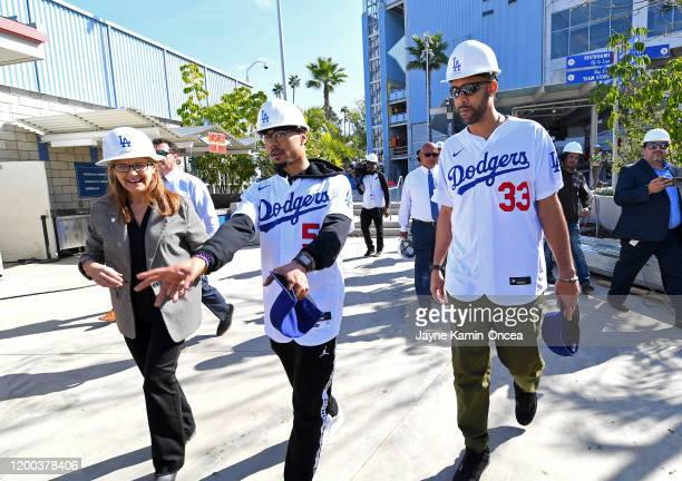 Los Angeles Dodgers senior view president of planning and development Janet Marie Smith gives Mookie Betts and David Price a tour of the new outfield...