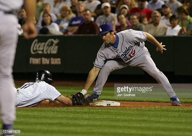 Los Angeles Dodgers Shawn Green tags out Colorado Rockies Brad Hawpe in the 2nd inning Friday September 17 2004 at Coors Field in Denver Colorado The...