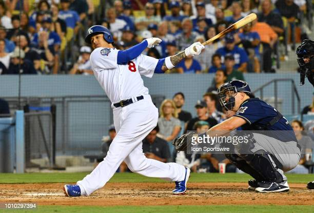 Los Angeles Dodgers shortstop Manny Machado swings at a pitch during a MLB game between the Milwaukee Brewers and the Los Angeles Dodgers on July 3...