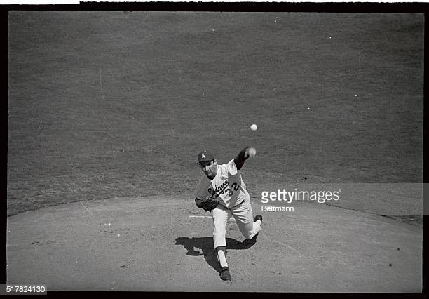 Los Angeles Dodgers' southpaw pitcher Sandy Koufax pitches against the New York Yankees here in the 4th World Series game 106 With 3 straight wins...