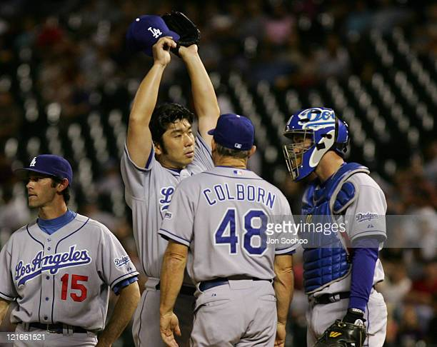Los Angeles Dodgers starting pitcher Hideo Nomo struggles vs Colorado Rockies as pitching coach Jim Colborn speaks Friday, September 17, 2004 at...