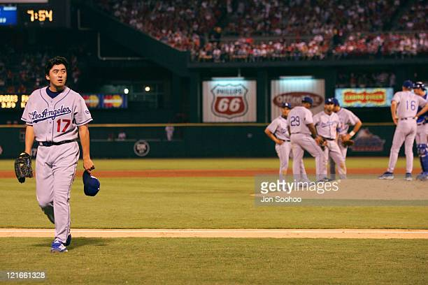 Los Angeles Dodgers starting pitcher Kazuhisa Ishii walks off the field after giving up 2 runs on two hits vs St. Louis Cardinals Saturday, September...