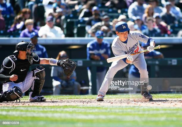 Los Angeles Dodgers Starting Pitcher, Kenta Maeda lays down a sac bunt during a regular season MLB game between the Colorado Rockies and the visiting...