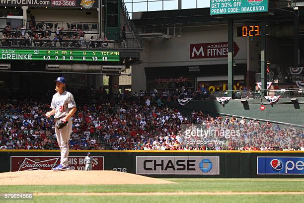 Los Angeles Dodgers starting pitcher Zack Greinke stands on the mound ready to pitch prior to the end of the game clock during the Major League...