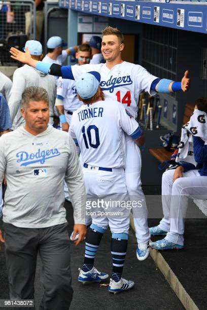 Los Angeles Dodgers third baseman Justin Turner lifts Los Angeles Dodgers outfielder Enrique Hernandez up before a MLB game on Father's Day between...