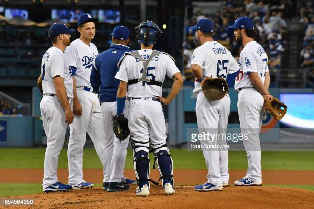 Los Angeles Dodgers third baseman Logan Forsythe shortstop Corey Seager manager Dave Roberts catcher Austin Barnes first baseman Kyle Farmer and...