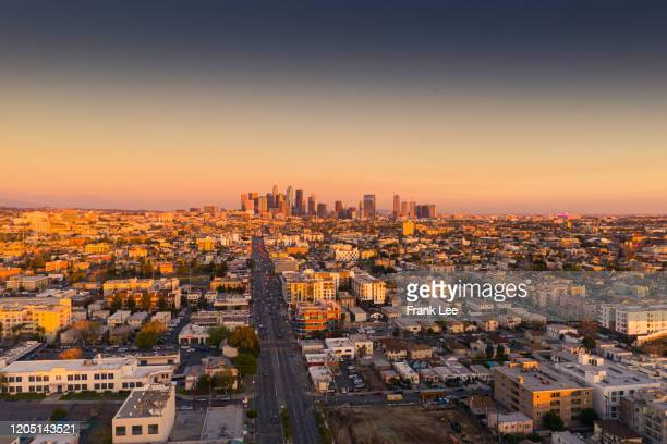 los angeles downtown aerial view at sunset - city of los angeles stock pictures, royalty-free photos & images