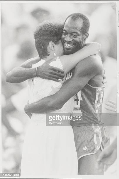 Edwin Moses the great American Olympic star who has won 105 races unbeaten hugs his wife Myrella after his victory in the 400meter event in Los...