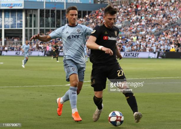 Los Angeles FC defender Tristan Blackmon clears the ball before Sporting Kansas City forward Krisztian Nemeth can make a play in the first half of an...