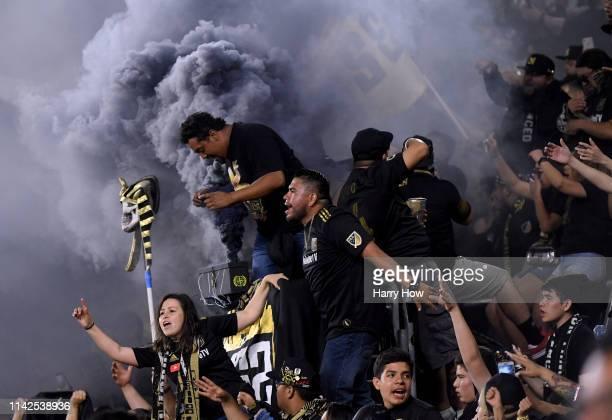 Los Angeles FC fans celebrate a 2-0 win over FC Cincinnati at Banc of California Stadium on April 13, 2019 in Los Angeles, California.